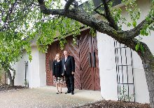 Pastor Steve Leathley and wife Sonja are pictured in front of the historic stone building. The grand opening will be June 26. Everyone is welcome and invited to attend this first service.
